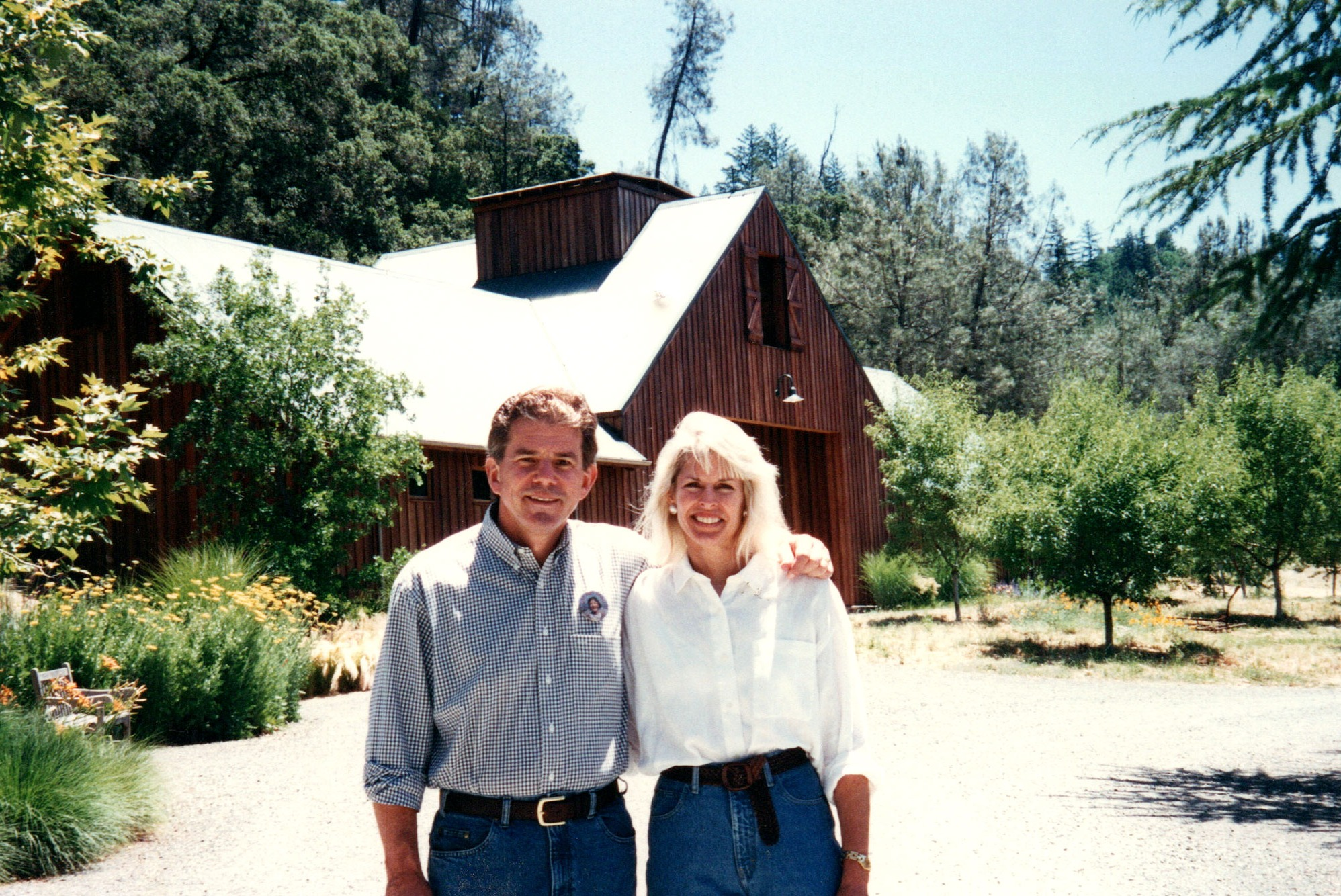 Daphne and Bart Araujo at Eisele Vineyard in front of the Araujo Estate Winery. (1996)