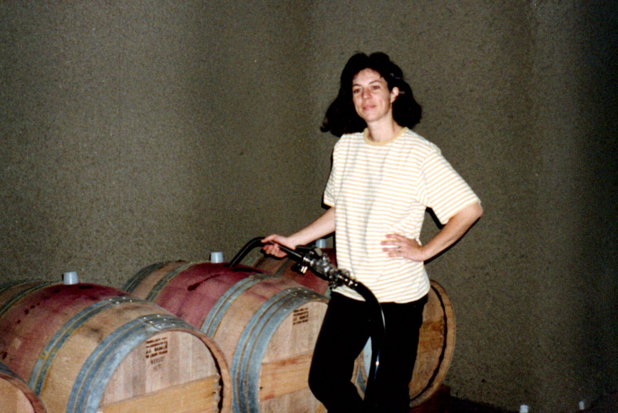 Françoise Peschon working in the Araujo Estate cellar at Eisele Vineyard. (1994)