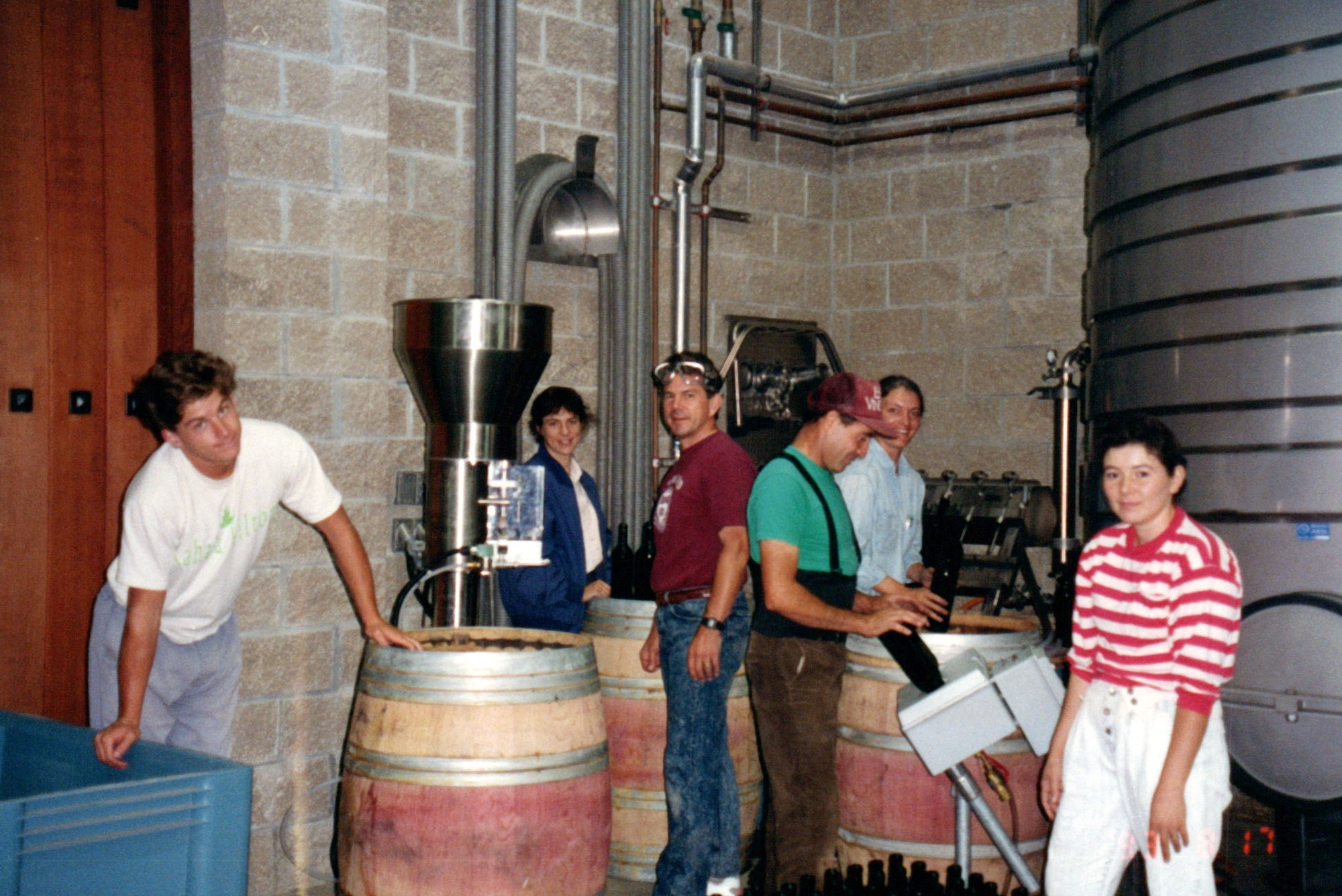 Bart and Greg Araujo with Françoise Peschon and the Araujo Estate winemaking team in the cellar during harvest at Eisele Vineyard. (1993)