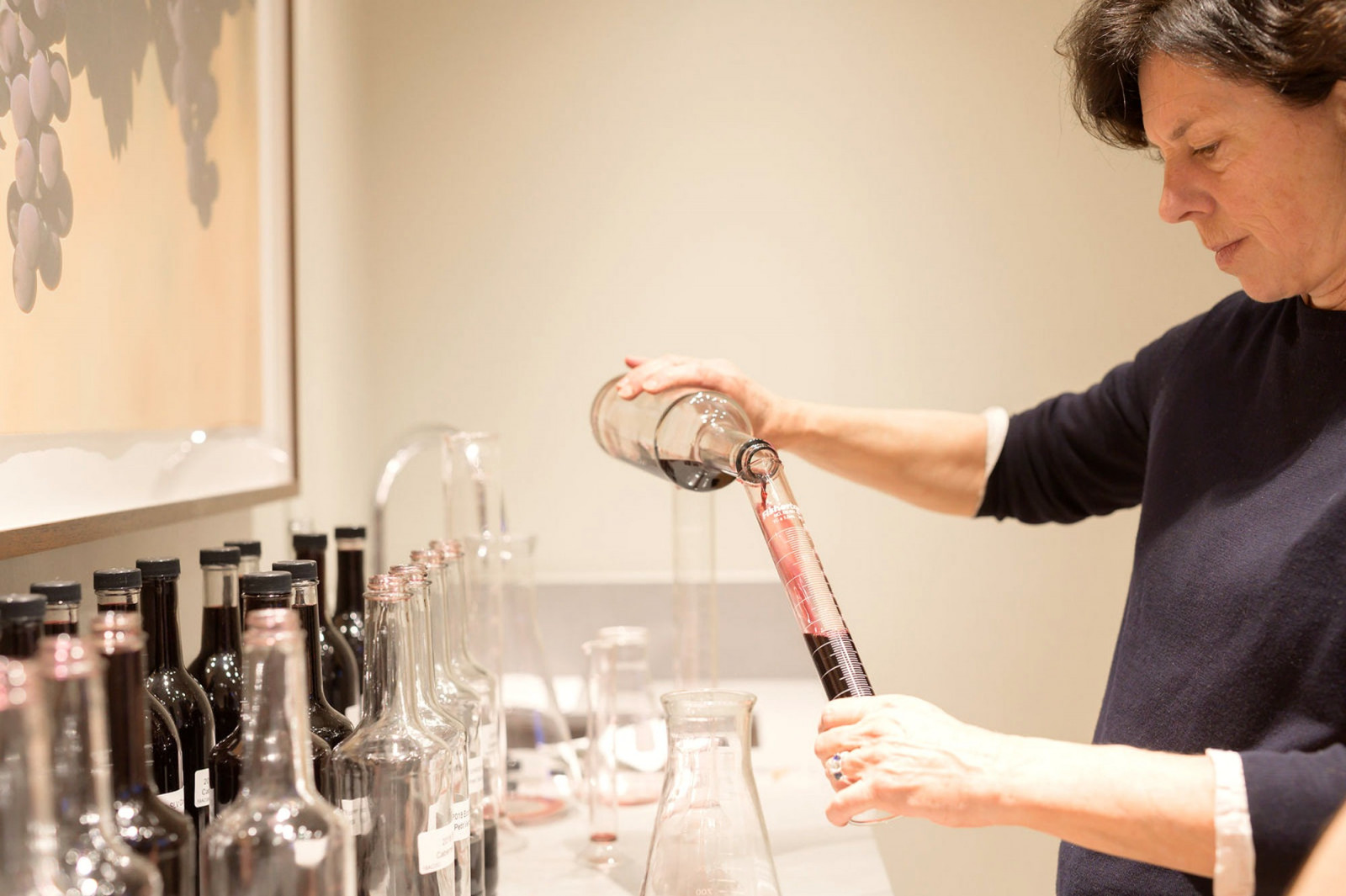 Françoise Peschon blending Cabernet Sauvignon during a blending session.
