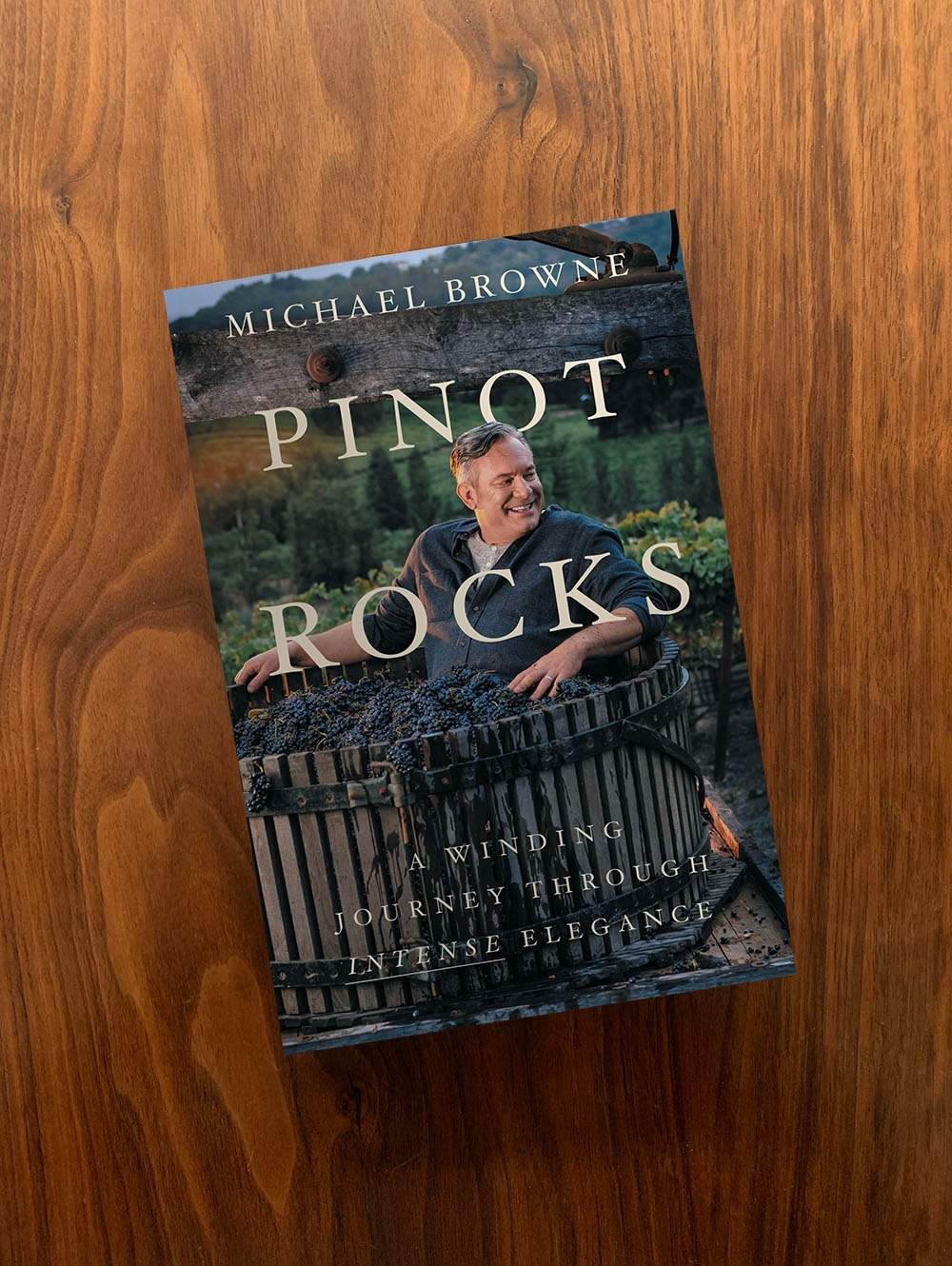Cover of the Michael Browne Book Pinot Rocks with him sitting in a vat of grapes