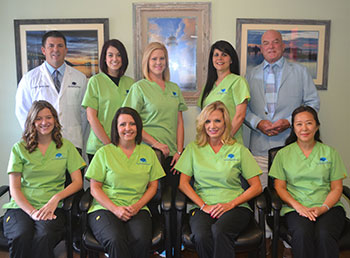 Back Bay Family Dentistry team posing in front of their dental office