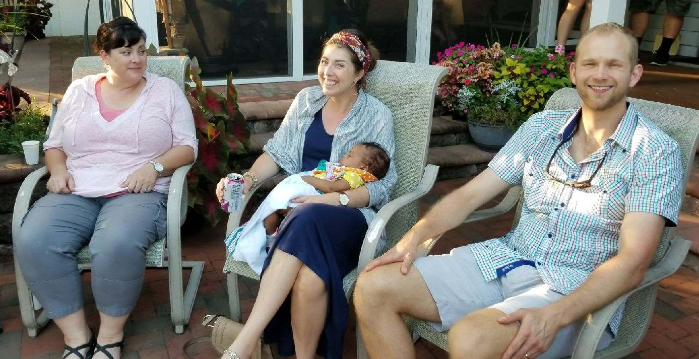 Amy, Dr. Rockey, and Carl with a cute baby