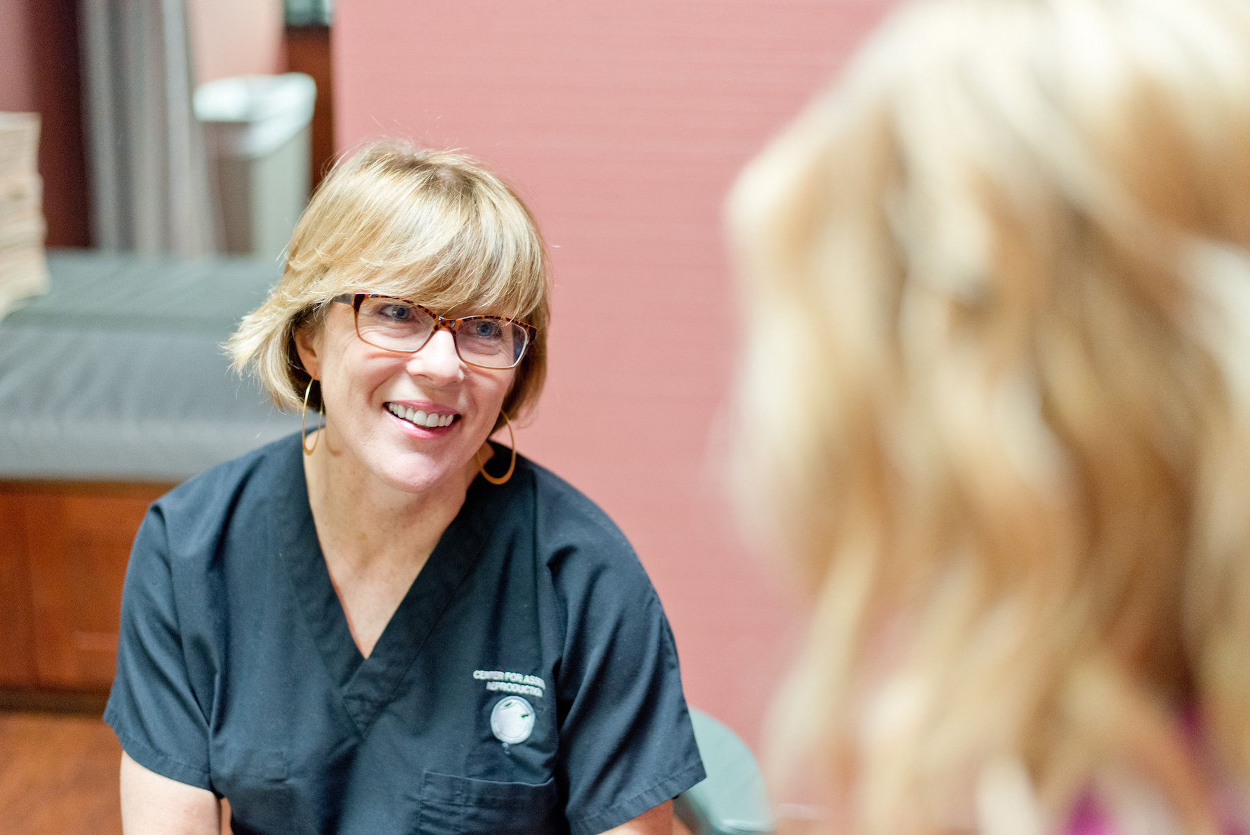 Dr. Kathy Doody with a patient