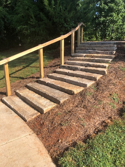 Stone steps with wooden handrails
