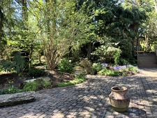 Photograph J: Southwestern Garden Patio with a wood bench
