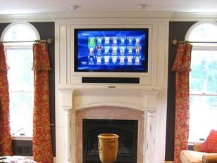 One Sound Choice built this soundbar into the wall along with the flush-mounted TV.