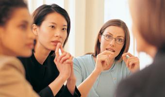 Diverse meeting businesswomen