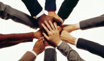 Team hands stock
