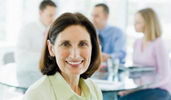 Woman smiling at camera stock