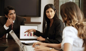 Woman speaking during meeting thinkstockphotos
