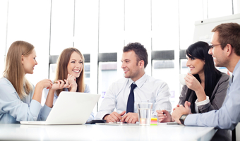 Woman smiling at meeting shutterstock
