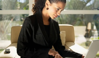 Businesswoman using laptop thinkstockphotos