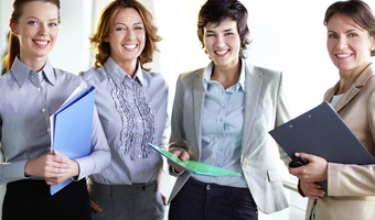 Female colleagues smiling thinkstockphotos