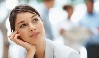 Young businesswomen thinking looking thinkstockphotos