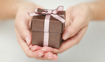 Small gift in hands thinkstock
