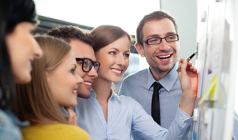 Colleages working and smiling thinkstockphotos 162729877