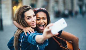 Two friends selfie shutterstock 199956071