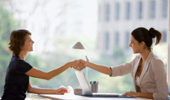 Businesswomen shaking hands gettyimages
