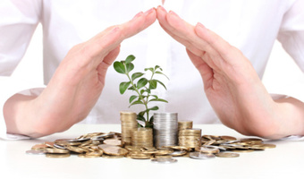 Woman growing money tree thinkstockphotos