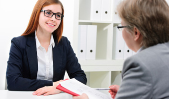 Older woman interviewing young woman thinkstockphotos 468763873