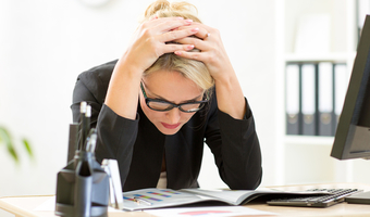 Stressed woman looking at data shutterstock