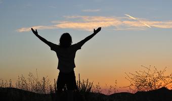 Hands in air sunset empowerment shutterstock