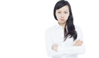 Woman with crossed arms thinkstockphotos 469302218