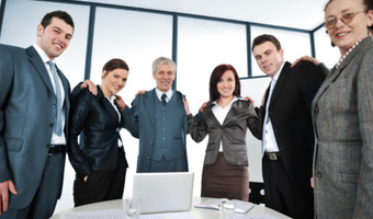 Coed business team smiling thinkstockphotos