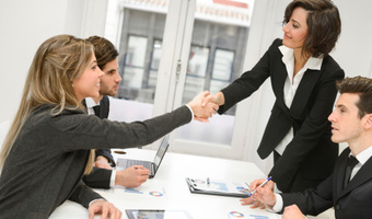 Businesswomen shaking hands at meeting thinkstockphoto