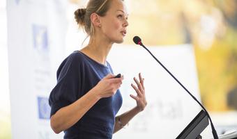 Businesswoman gives presentation thinkstockphotos