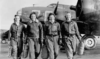 Group of women airforce service pilots and b 17 flying fortress