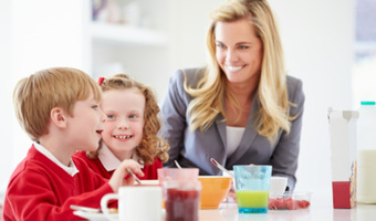 Mother with kids in kitchen thinkstockphotos