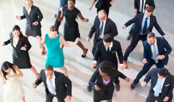 Business people dancing at work