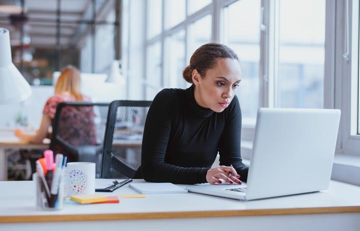 Woman working at desk thinkstockphoto