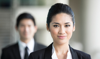 Businesswoman smiling formal thinkstockphoto