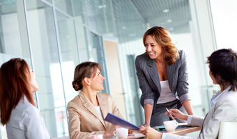 Female colleagues laughing thinkstock