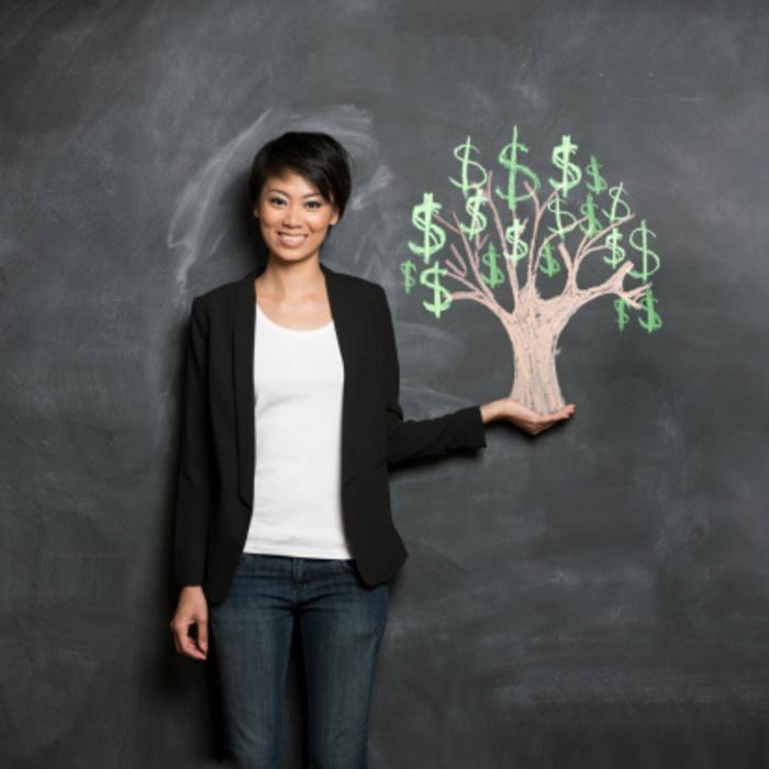Woman holding money tree