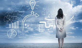Woman looking at marketing flowchart thinkstock