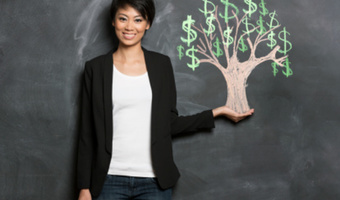 Woman holding money tree