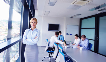 Woman standing modern office thinkstockphoto
