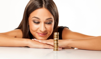 Woman with stack of coins stock