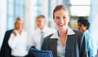 Businesswoman smiles office thinkstockphoto