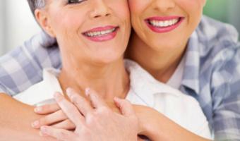 Adult daughter hugging mother thinkstock