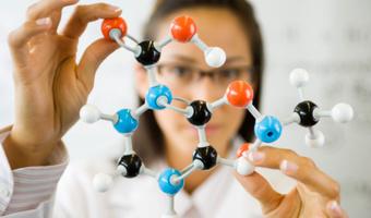 Female scientist holding molecule thinkstockphotos
