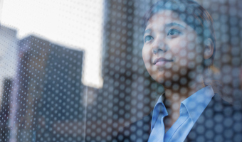 Businesswoman looking out window thinkstockphotos
