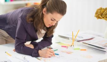 Woman writing drawing plan
