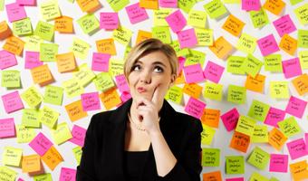 Businesswoman thinking post it notes thinkstockphotos