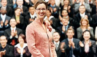 Businesswoman presenting before big group thinkstockphotos