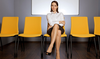 Businesswoman sitting in chair thinkstockphoto